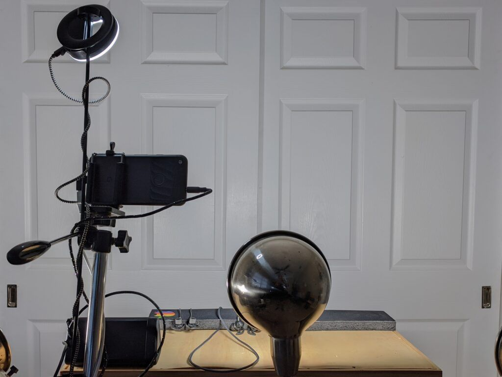 We use a headset, external microphone, studio lights, and a plain white background. Camera, Lighting, and Microphone for Virtual Court Appearance